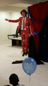 Holiday/Birthday Party photo Magic Michael - floating in red - Dec 9, 2017.jpg