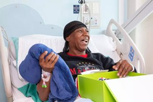 Virtual Team Building - Benefit Veterans photo RbACares_Cheeriodicals hospital happy vet 4x6.jpg