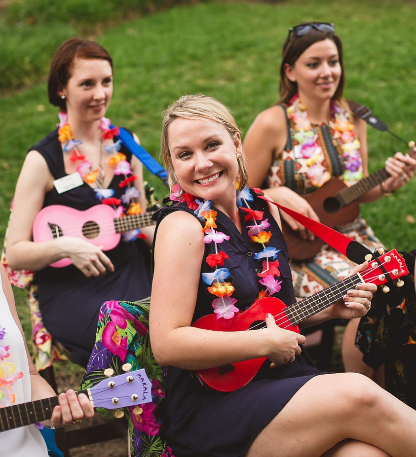 Play That Uke Team Building photo First class, blonde woman smiling, cropped photo.jpg