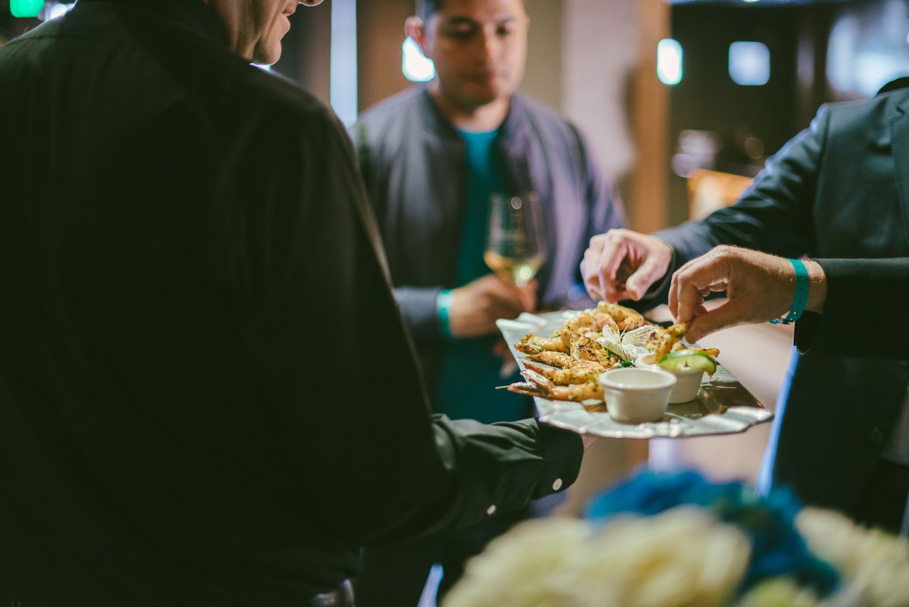 All-Hands Meeting for AltaMed photo Employees Enjoying Hand Passed Snacks After Meeting.jpg