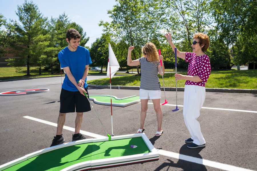 Authentic Putt Putt Golf: Mini-Golf-Rental-NJ-Green-Course-Putting-into-the-Cup.jpg