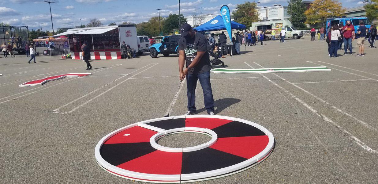Authentic Putt Putt Golf: Mini-Golf-Rentals-NJ-Festivals-Roulette-Wheel-Hole-with-Player-putting.jpg