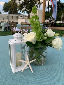 Seaside Soiree photo Centerpiece - Guiding light with small white lantern, starfish, cylinder with roses, bells of ireland.jpg