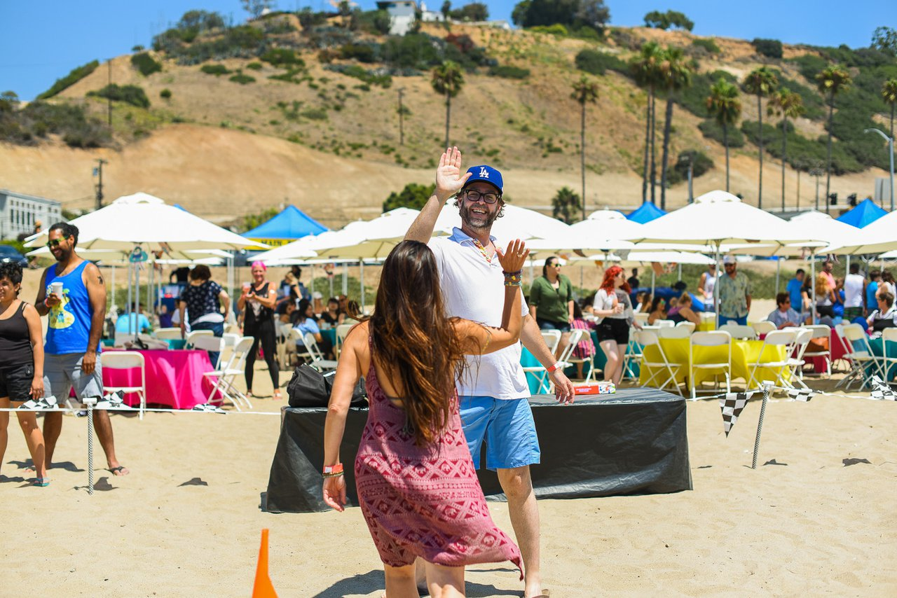 Cartoon Network's Beach Picnic photo employees team building high five at Cartoon Network-2017 Company Outing.jpg