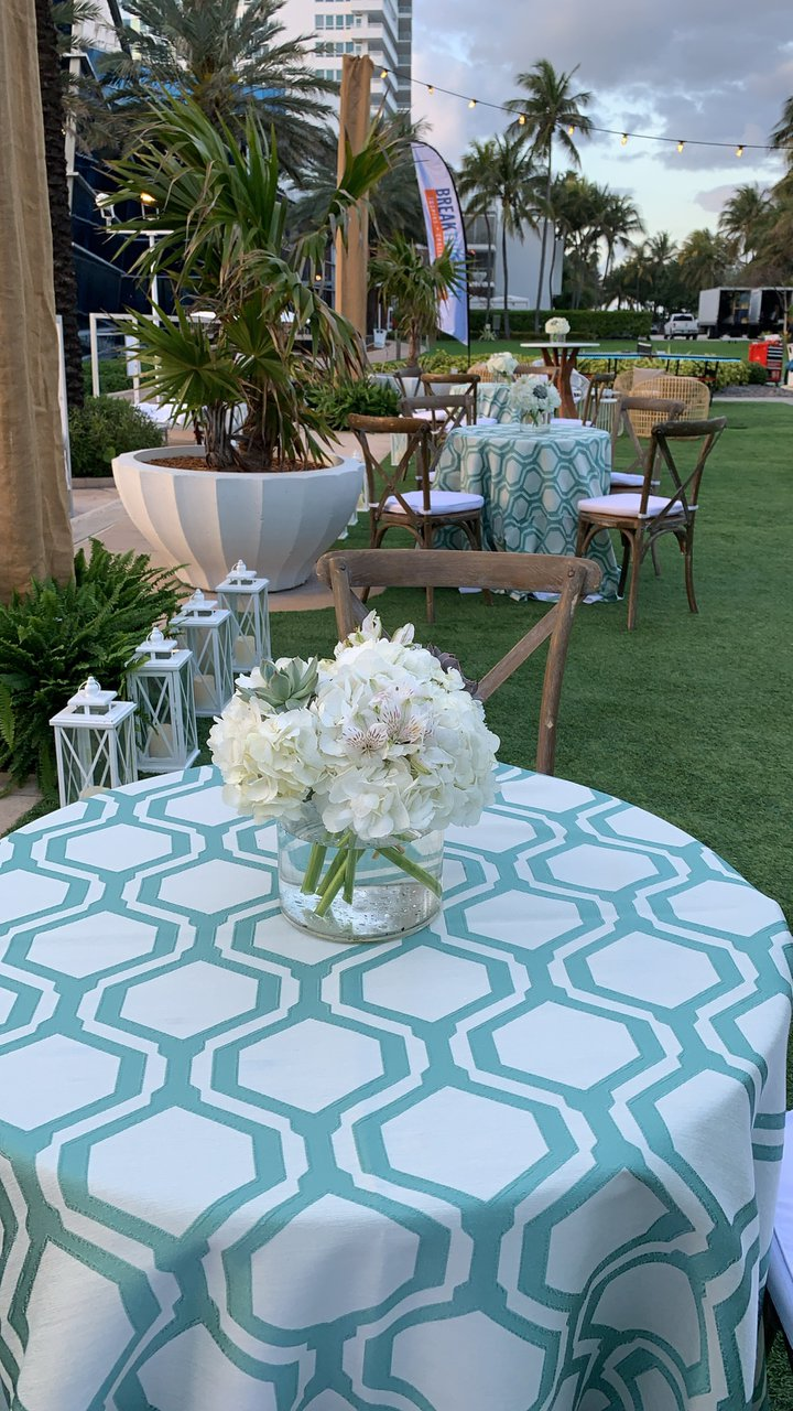 Seaside Soiree photo Succulent Chic centerpiece on aqua honeycomb cocktail table.jpg
